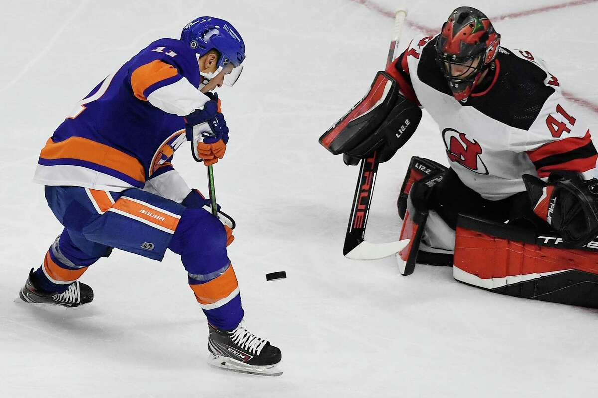 The New York Islanders' Zach Parise, left, takes a shot on a breakaway against New Jersey Devils goalie Scott Wedgewood during a preseason game Saturday in Bridgeport.