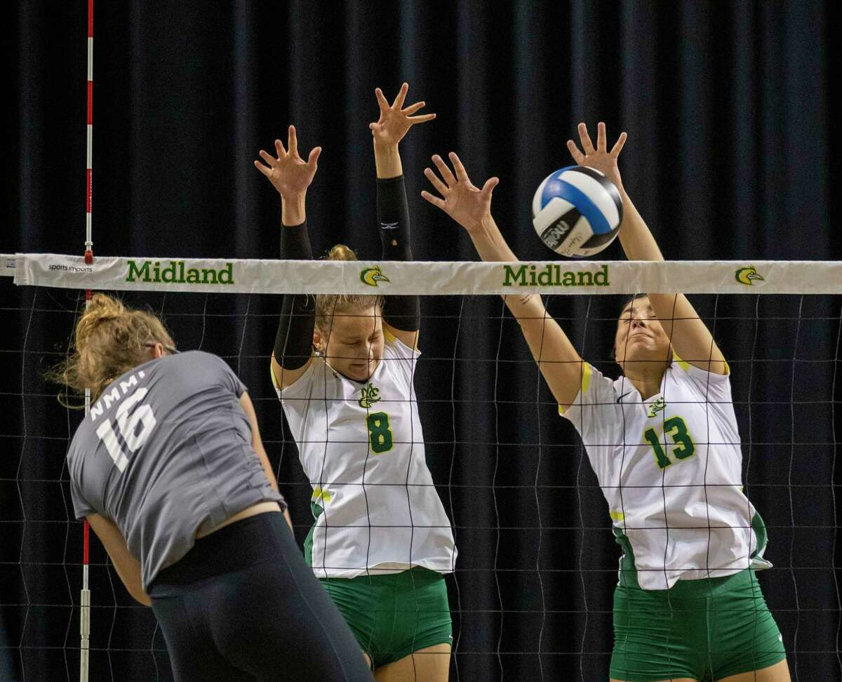 Midland College's Lucie Maceckova (8) and Macarena Flores (13) block New Mexico Military Institute's Darcy Dodd's (16) hit Saturday, Oct. 2, 2021 at Chaparral Center. Jacy Lewis/Reporter-Telegram