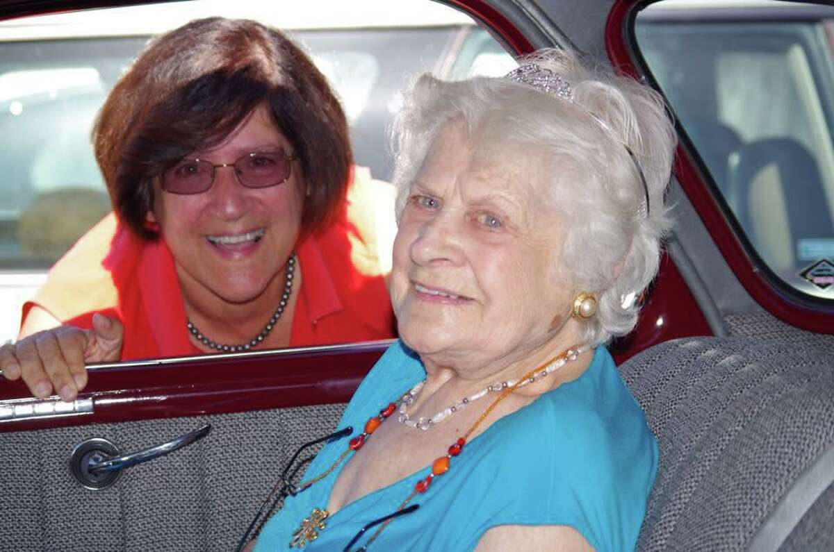 Dorene Giacopini (left) and her mother, Primetta Giacopini (right) at Primetta's 100th birthday party. Primetta is sitting in a 1940 Chevrolet similar to the one she bought when she arrived to the United States at the age of 25.