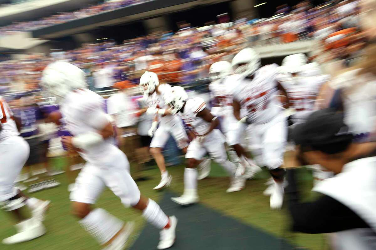 Texas takes the field before playing TCU in an NCAA college football game Saturday, Oct. 2, 2021, in Fort Worth, Texas. (AP Photo/Ron Jenkins)