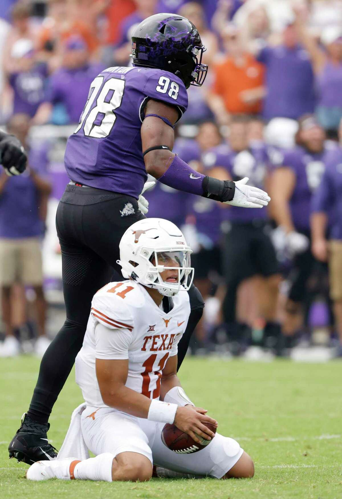 TCU defensive end Dylan Horton (98) reacts after Texas quarterback Casey Thompson (11) was sacked during the first half of an NCAA college football game Saturday, Oct. 2, 2021, in Fort Worth, Texas. (AP Photo/Ron Jenkins)