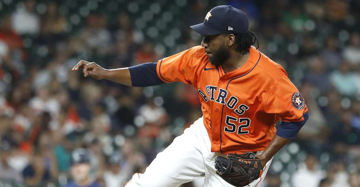 Houston Astros relief pitcher Pedro Baez (52) pitches during the eighth inning of an MLB baseball game at Minute Maid Park, Friday, August 20, 2021, in Houston.