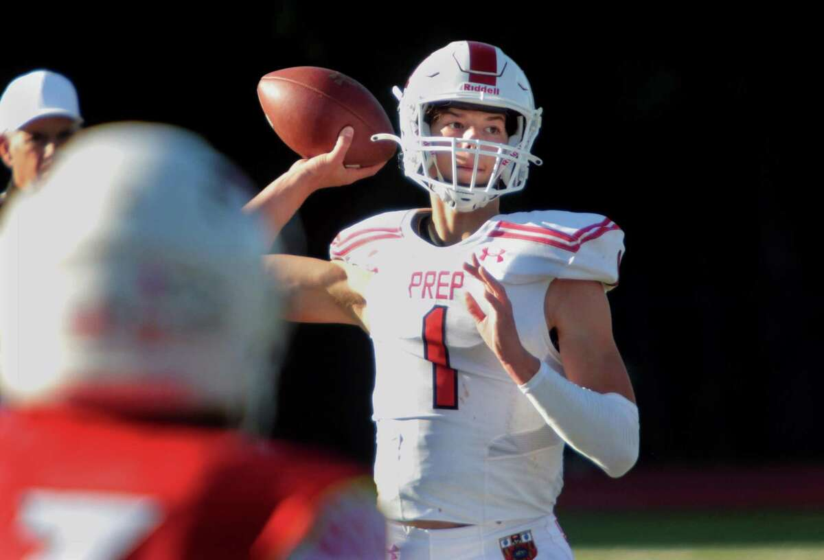 Fairfield Prep quarterback Connor Smith throws a pass against Greenwich on Saturday in Greenwich.