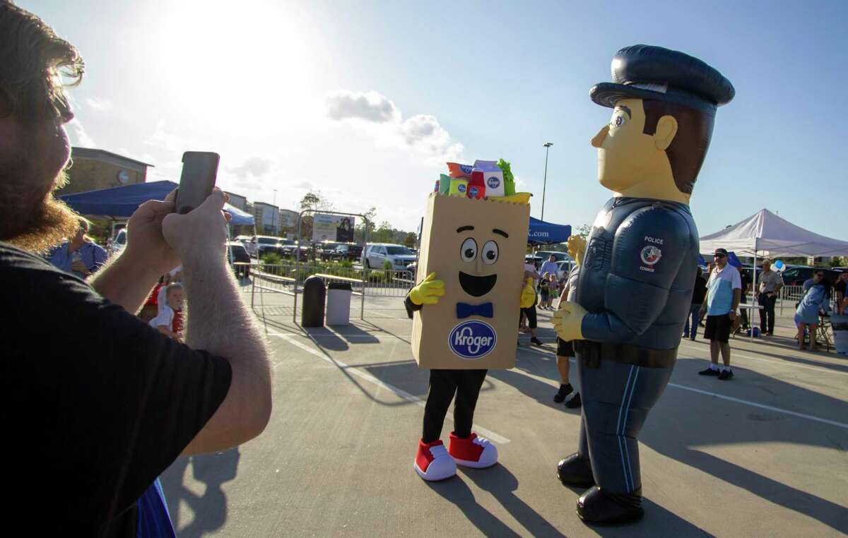 Mascots for Kroger and Conroe Police Department greet guests during National Night Out on October 1, 2019 at Kroger Marketplace in Conroe.