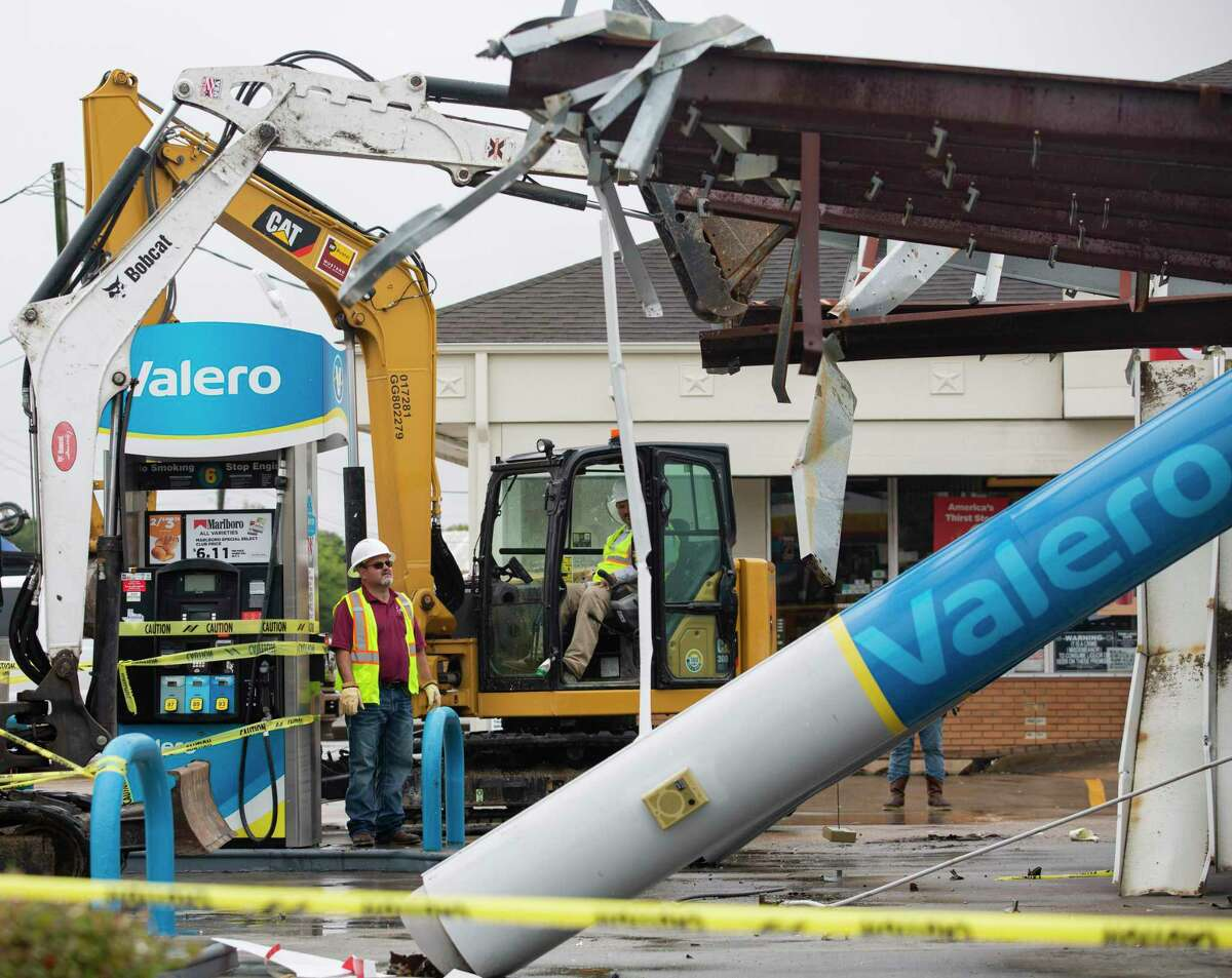 Demolition has begun at a gas station damaged by the winds from Hurricane Nicholas Tuesday, Sept. 14, 2021, in Texas City.