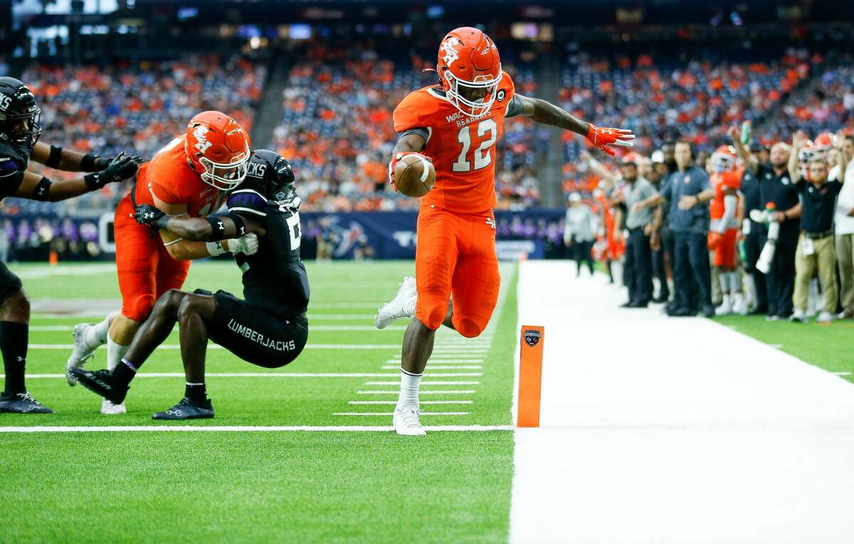 Sam Houston State Bearkats wide receiver Jequez Ezzard (12) scores a five-yard receiving touchdown against the Stephen F. Austin Lumberjacks during the second quarter of an NCAA game at NRG Stadium on Saturday, Oct. 2, 2021, in Houston.