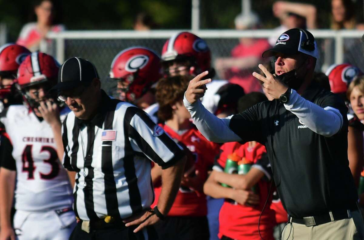 Rams Head Coach Don Drust, right, leads his team as The Norwalk High School Bears take on the Cheshire High School Rams during their CIAC football game Saturday, October 2, 2021, at Testa field in Norwalk, Conn.