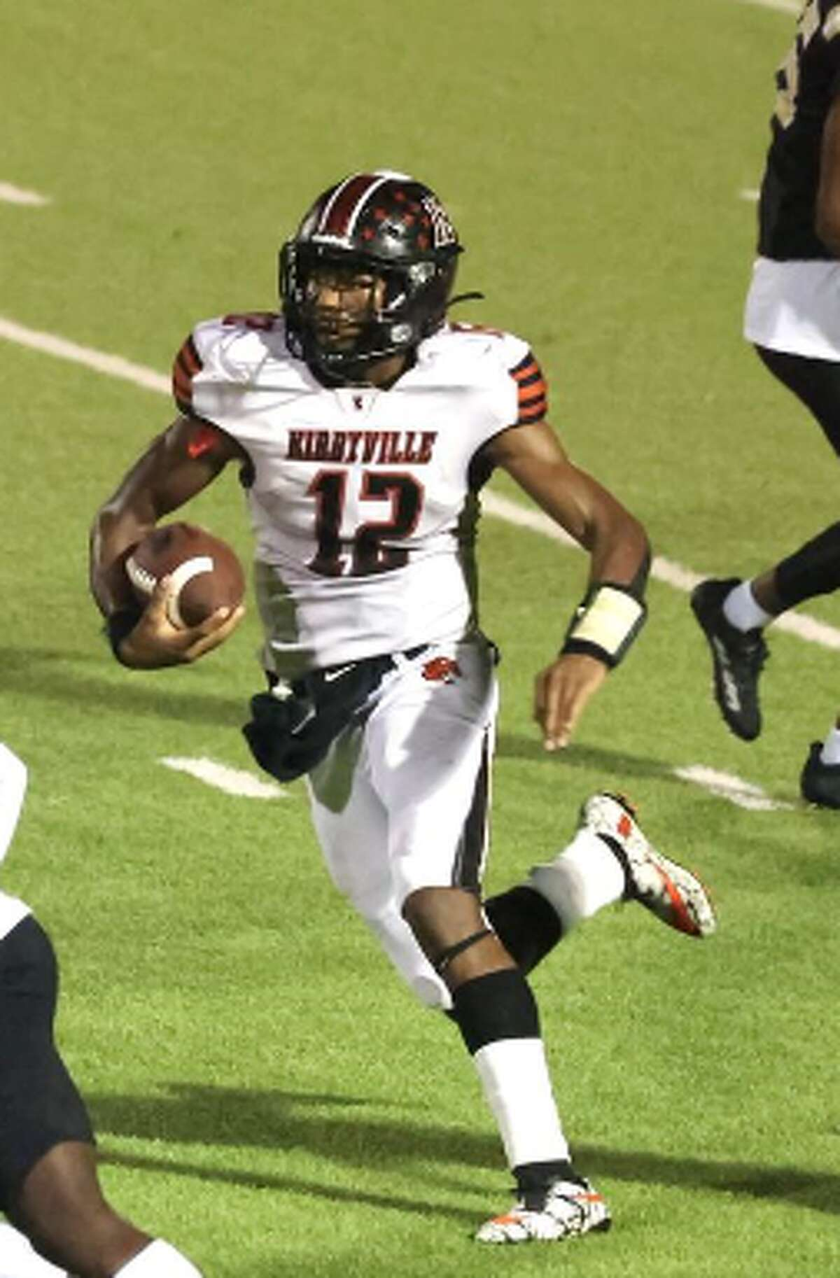 Kirbyville quarterback Braydon Mahathay looks for room to run in Friday's game against Woodville.