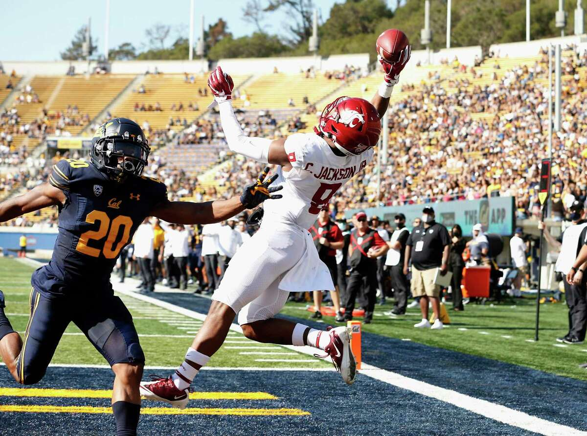 Washington State Cougars wide receiver Calvin Jackson Jr. (8) catches a touchdown pass in front of California Golden Bears cornerback Josh Drayden (20) in the first quarter during an NCAA football game on Saturday, Oct. 2, 2021 in Berkeley, Calif. (AP Photo/Lachlan Cunningham)