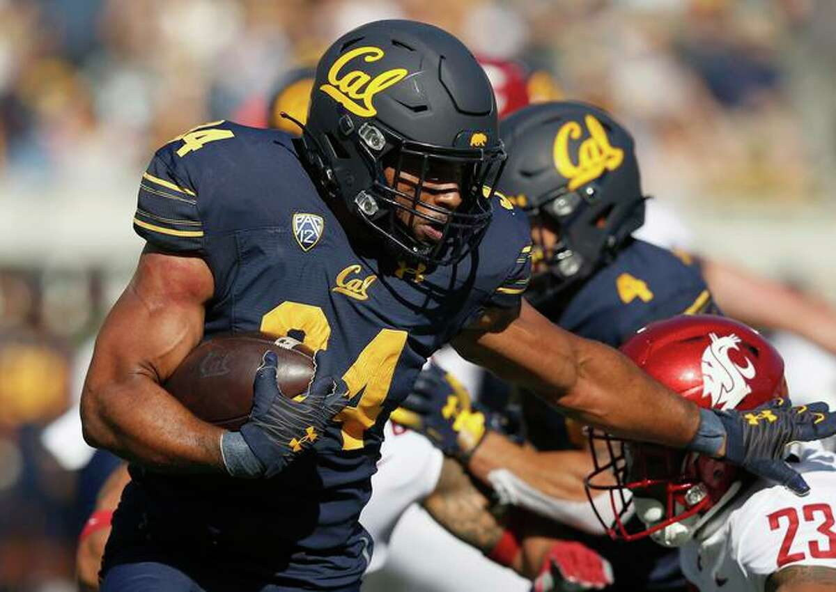 Cal's Christopher Brooks (34) evades a tackle by Washington State's Kaleb Ford-Dement (23) in the first half. Brooks had the Bears' only touchdown.
