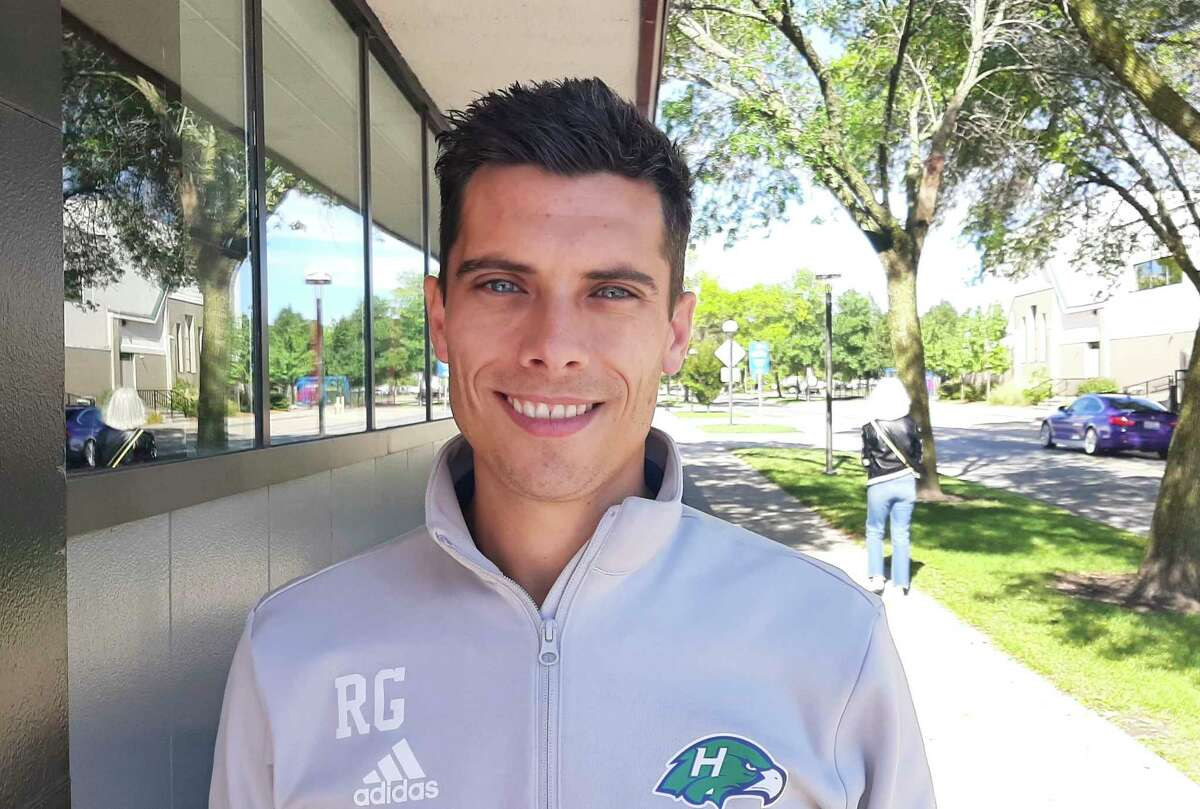 """Ross Gibson, now of Freeland, played soccer in Hull, England, before coming to the United States to coach summer camps. Since then, he has coached with several teams, both locally and on the professional level. Gibson'sfavorite part about coaching soccer is helping others """"to improve their game... to advance,"""" he said.He also teaches computer classes at a local school. (Photo by Niky House)"""