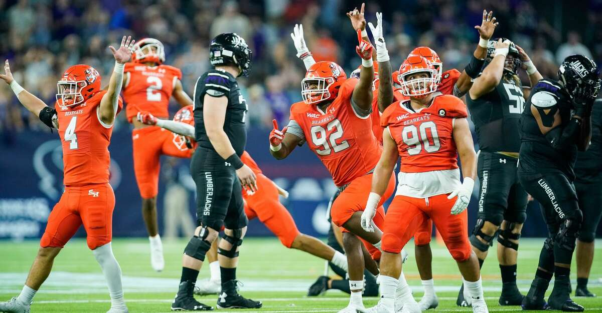 Sam Houston State Bearkats players celebrate after the Stephen F. Austin Lumberjacks missed what would have been the winning field goal in the fourth quarter of an NCAA game at NRG Stadium on Saturday, Oct. 2, 2021, in Houston. Sam Houston won 21-20.