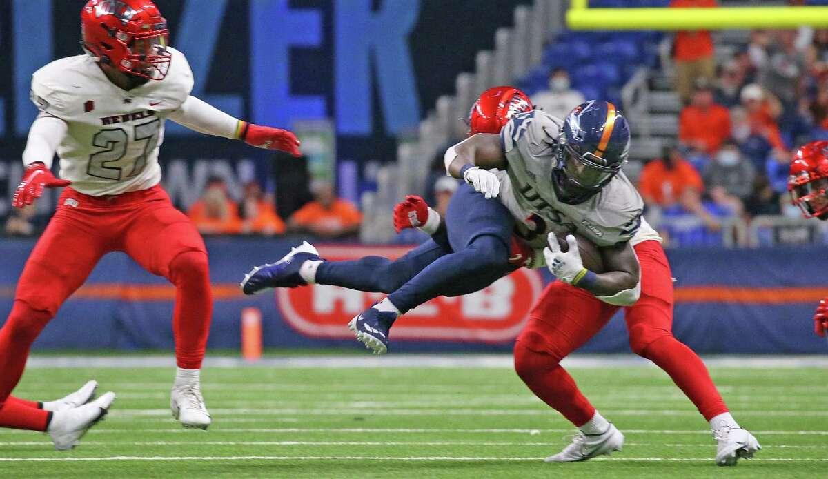 UTSA running back Sincere McCormick leaps over UNLV tackler on Saturday, Oct. 2, 2021.