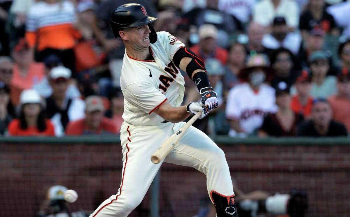 Buster Posey checks his swing as he pinch-hit in the 10th inning against the San Diego Padres at Oracle Park. Posey grounded out as the Giants lost 3-2.