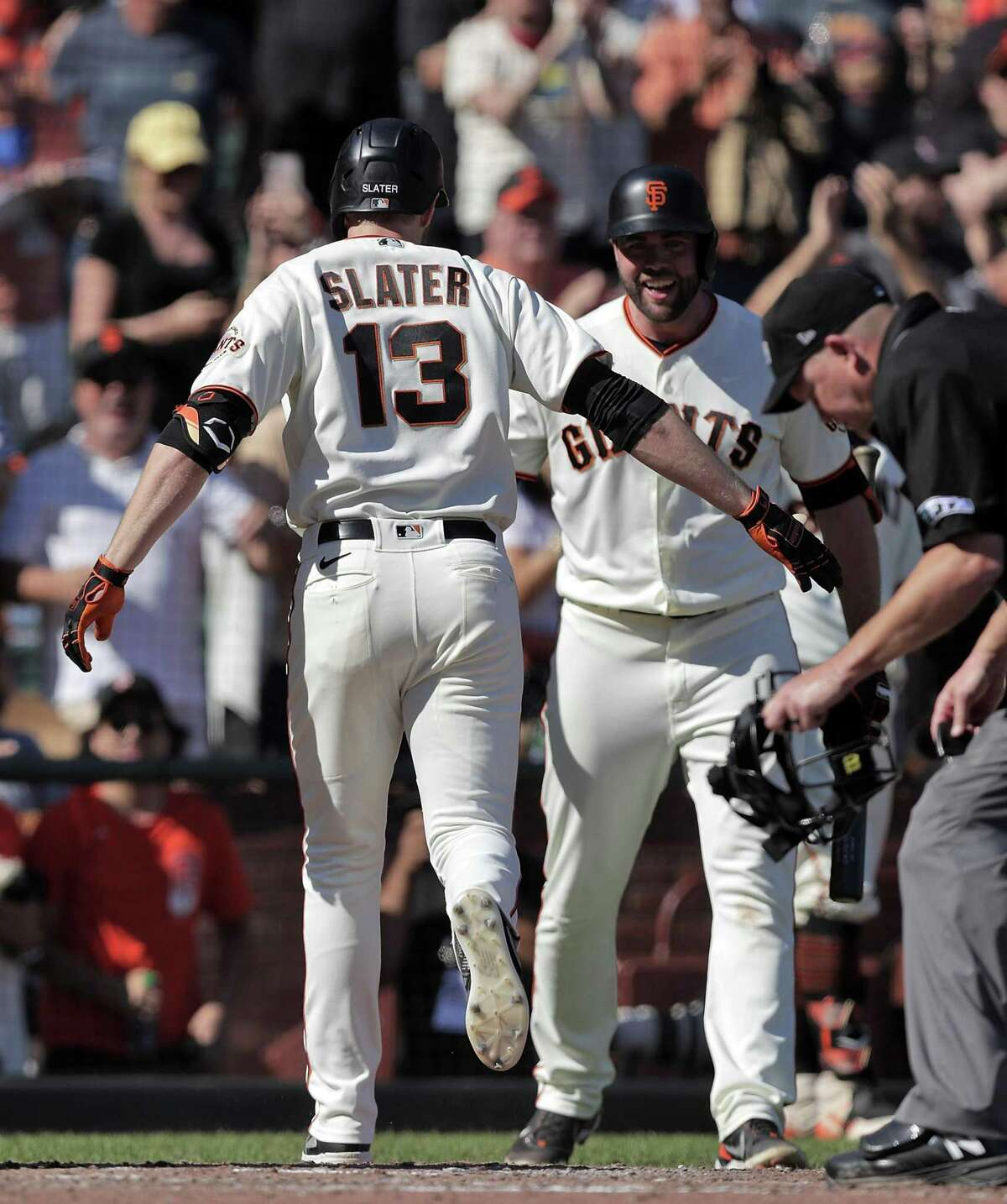 Austin Slater (13) scores on his solo homerun in the sixrth inning as the San Francisco Giants played the San Diego Padres at Oracle Park in San Francisco, Calif., on Saturday, October 2, 2021.