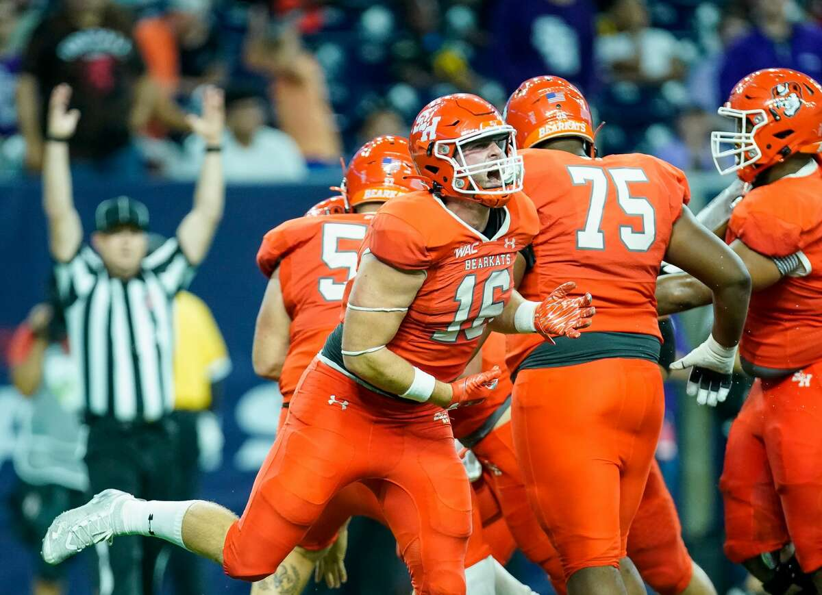 Sam Houston State Bearkats tight end Isaac Schley (16) celebrates after quarterback Trapper Pannell (10) scored a four-yard rushing touchdown against the Stephen F. Austin Lumberjacks during the fourth quarter of an NCAA game at NRG Stadium on Saturday, Oct. 2, 2021, in Houston. Sam Houston won 21-20.