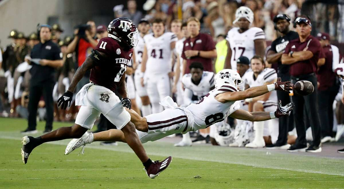 COLLEGE STATION, TEXAS - OCTOBER 02: Austin Williams #85 of the Mississippi State Bulldogs reaches for the ball as he is defended by Deuce Harmon #11 of the Texas A&M Aggies at Kyle Field on October 02, 2021 in College Station, Texas. (Photo by Bob Levey/Getty Images)