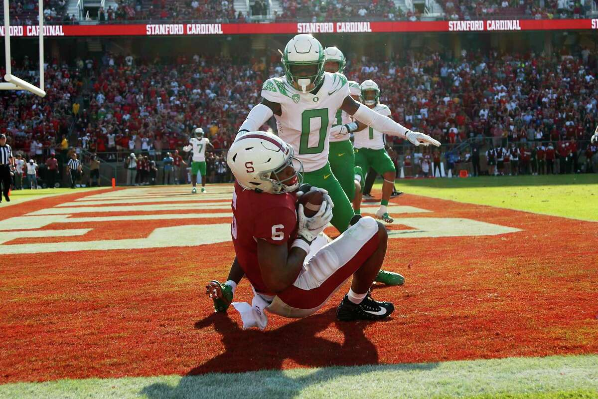CORRECTS ID TO ELIJAH HIGGINS NOT JAYLON REDD - Stanford's Elijah Higgins catches a touchdown against Oregons' DJ James (0) during the second half of an NCAA college football game in Stanford, Calif., Saturday, Oct. 2, 2021. (AP Photo/Jed Jacobsohn)