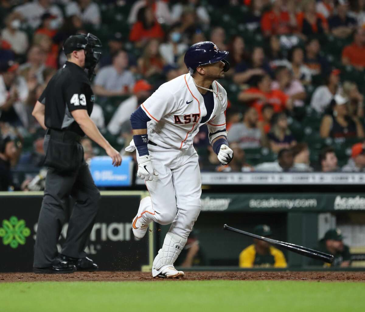 Houston Astros Yuli Gurriel (10) hits a home run, which was originally called a double, then overturned in a challenge during the third inning of an MLB baseball game at Minute Maid Park, Saturday, October 2, 2021, in Houston.