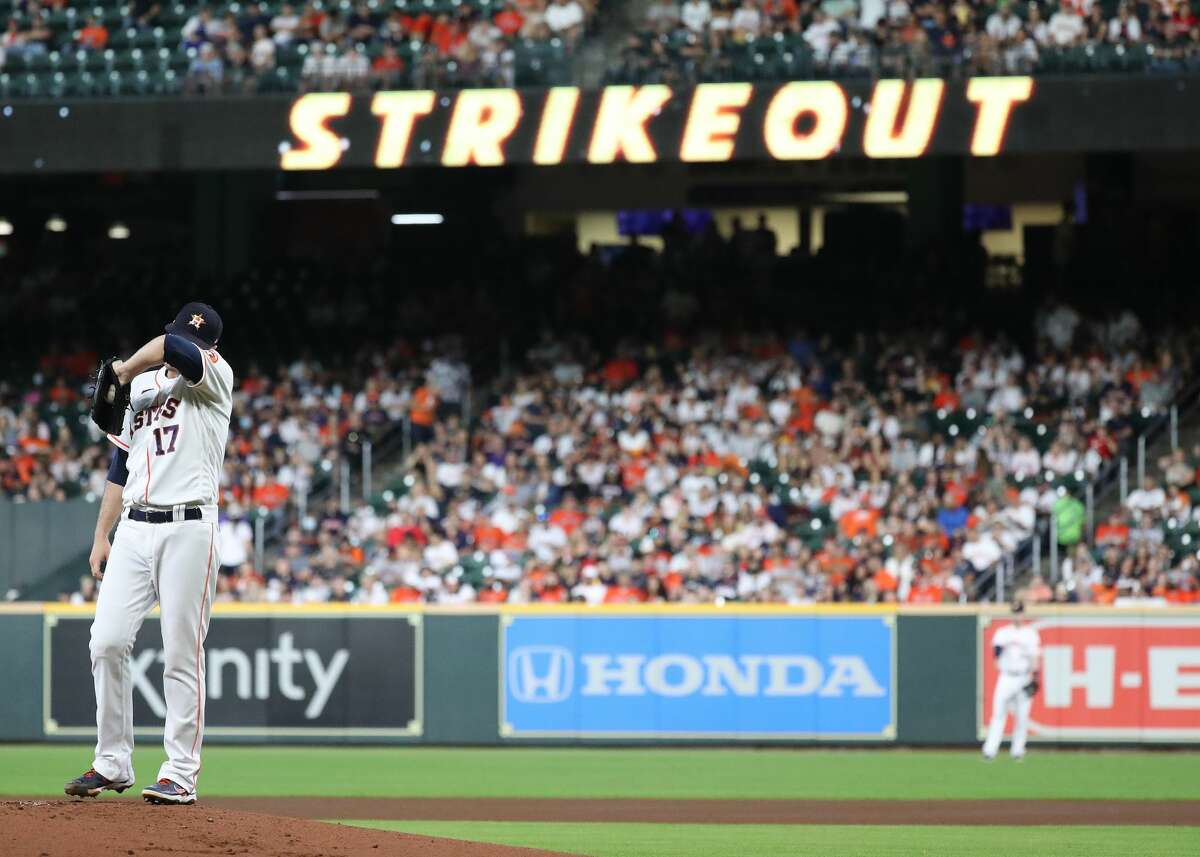 Houston Astros starting pitcher Jake Odorizzi (17) reacts after striking out Oakland Athletics first baseman Matt Olson during the first inning of an MLB baseball game at Minute Maid Park, Saturday, October 2, 2021, in Houston.