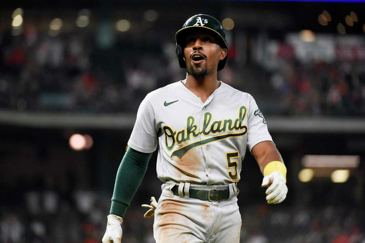 Oakland Athletics' Tony Kemp reacts after Houston Astros right fielder Kyle Tucker caught Kemp's fly ball to end the top of the sixth inning of a baseball game, Saturday, Oct. 2, 2021, in Houston. (AP Photo/Eric Christian Smith)