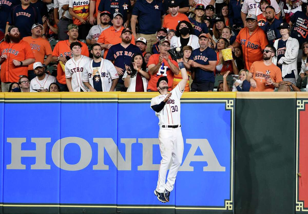 Houston Astros right fielder Kyle Tucker (30) catches the fly ball of Oakland Athletics' Tony Kemp to end the top of the sixth inning of a baseball game, Saturday, Oct. 2, 2021, in Houston. (AP Photo/Eric Christian Smith)