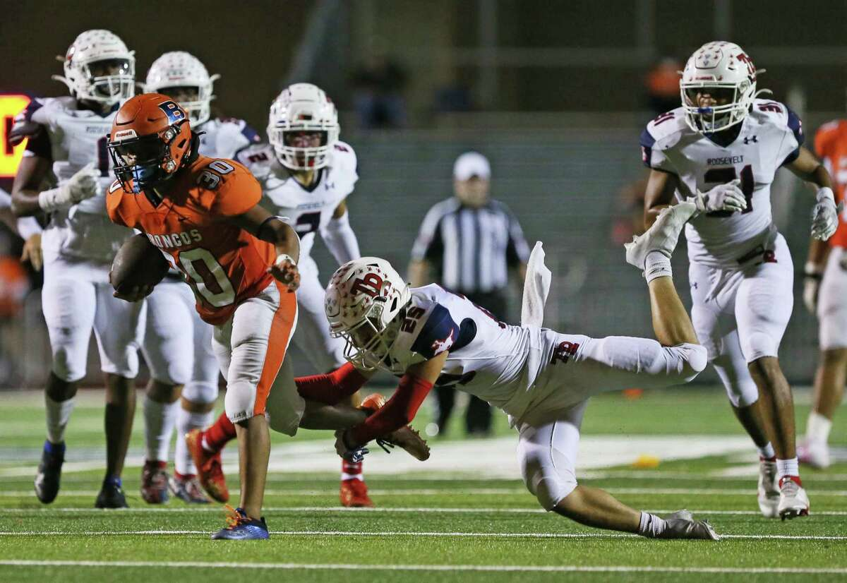 Brandeis running back Christopher Rodriguez (30) carries the ball during the UIL football game against Roosevelt on Saturday at Dub Farris Athletic Complex.