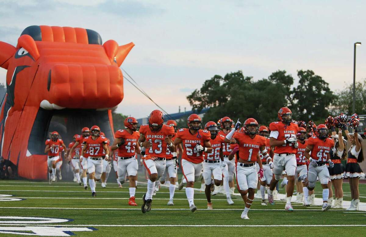 Members of the Brandeis football take to the field prior to the UIL football game against Roosevelt on Saturday at Dub Farris Athletic Complex.