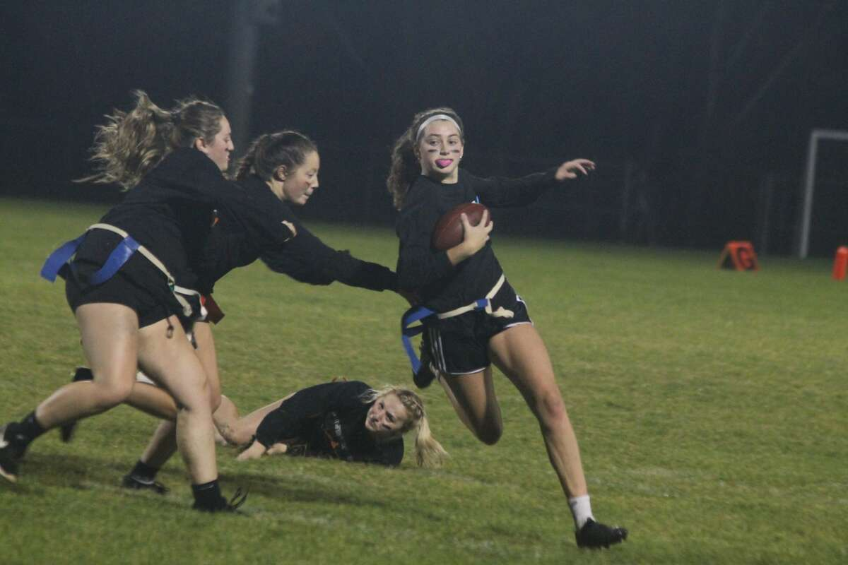 Manistee High School held powderpuff football and a bonfire at Chippewa Field on Friday night as part of its homecoming festivities.