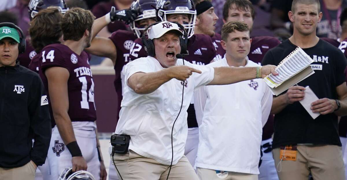 Texas A&M head coach Jimbo Fisher reacts as the play clock almost runs out on his offense during the first quarter of an NCAA college football game against Mississippi State, Saturday, Oct. 2, 2021, in College Station, Texas. (AP Photo/Sam Craft)