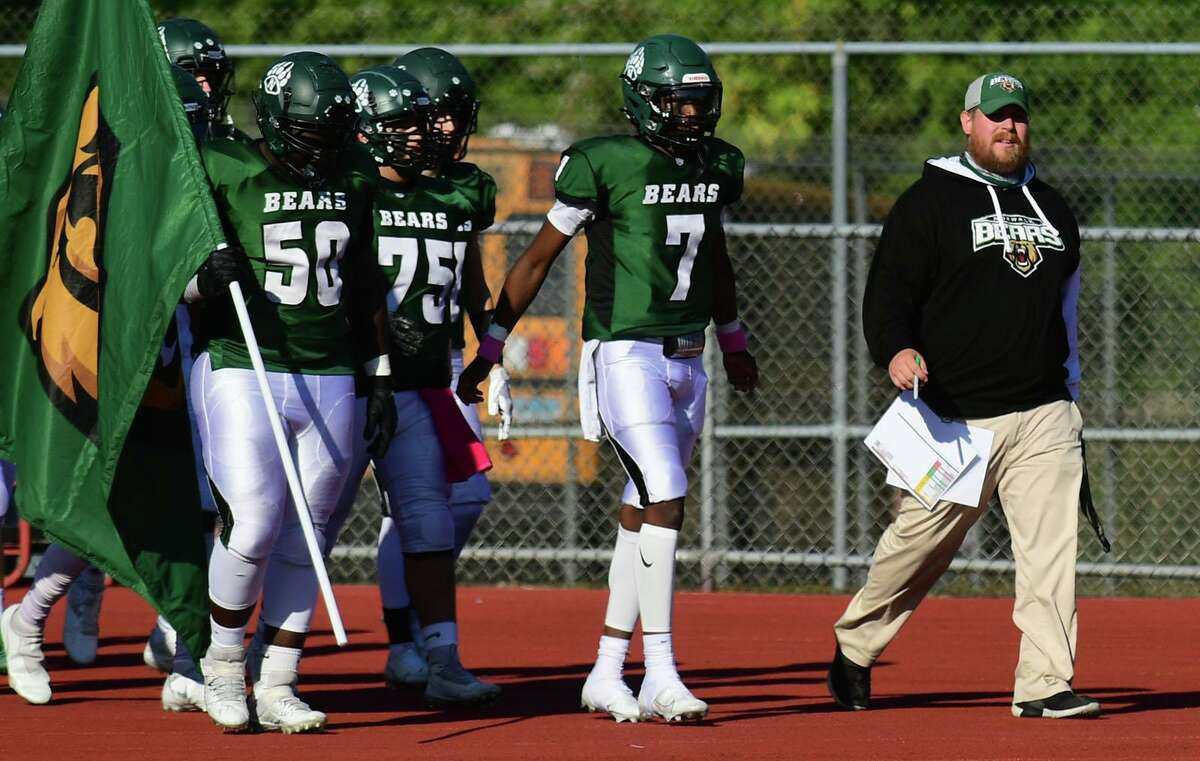 Norwalk's new head coach, Pat Miller, leads the Bears against Cheshire in Saturday's game at Testa Field in Norwalk.