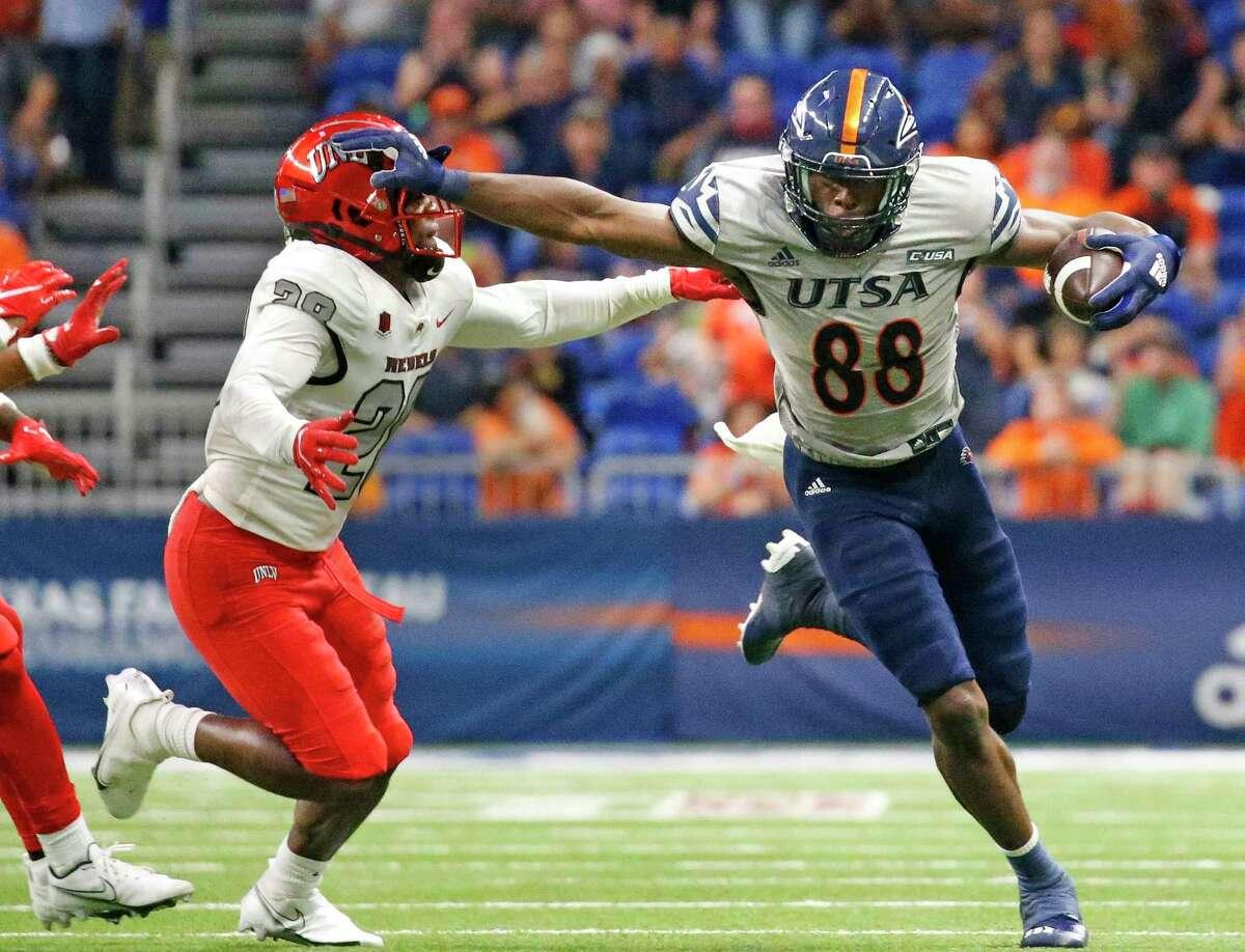 UTSA wide receiver De'Corian Clark stiff arms a UNLV player after a receptionon Saturday, Oct. 2, 2021.