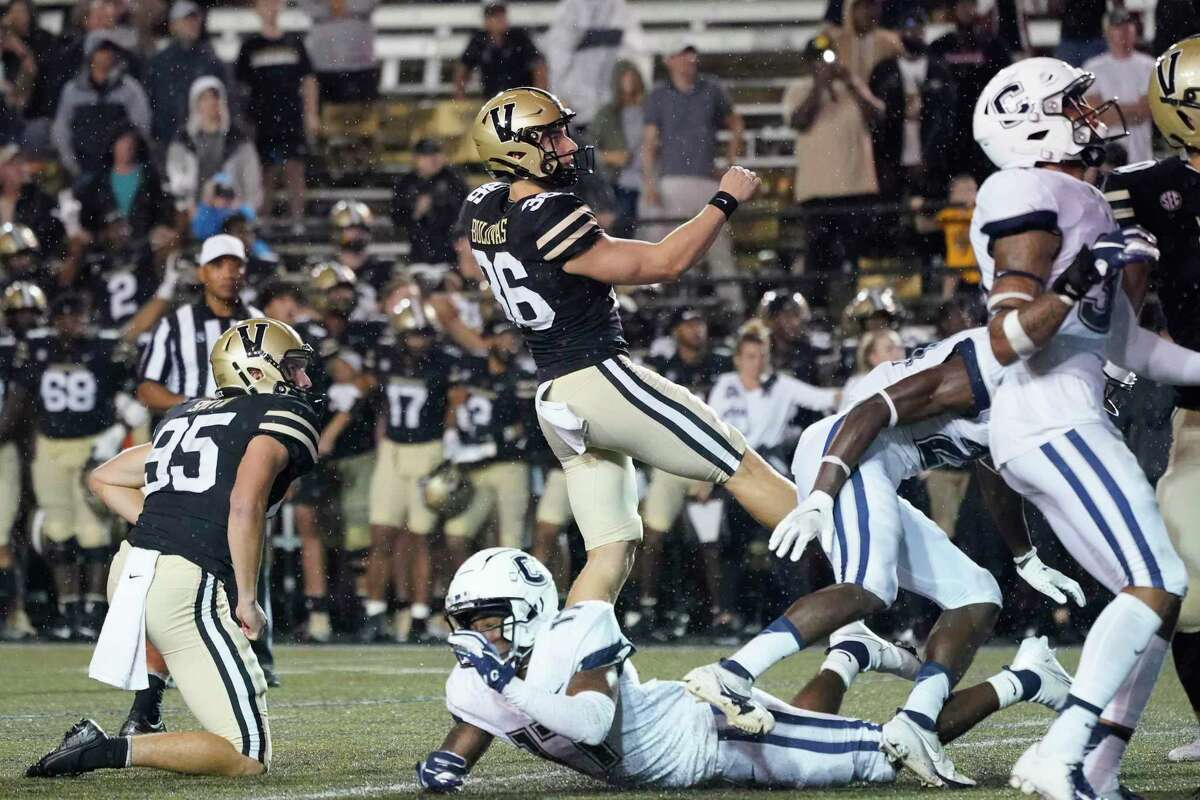 Vanderbilt place kicker Joseph Bulovas (36) watches his 31-yard field goal as time runs out in the fourth quarter to give Vanderbilt a 30-28 win over Connecticut in an NCAA college football game Saturday, Oct. 2, 2021, in Nashville, Tenn. At left is holder Harrison Smith (95). (AP Photo/Mark Humphrey)