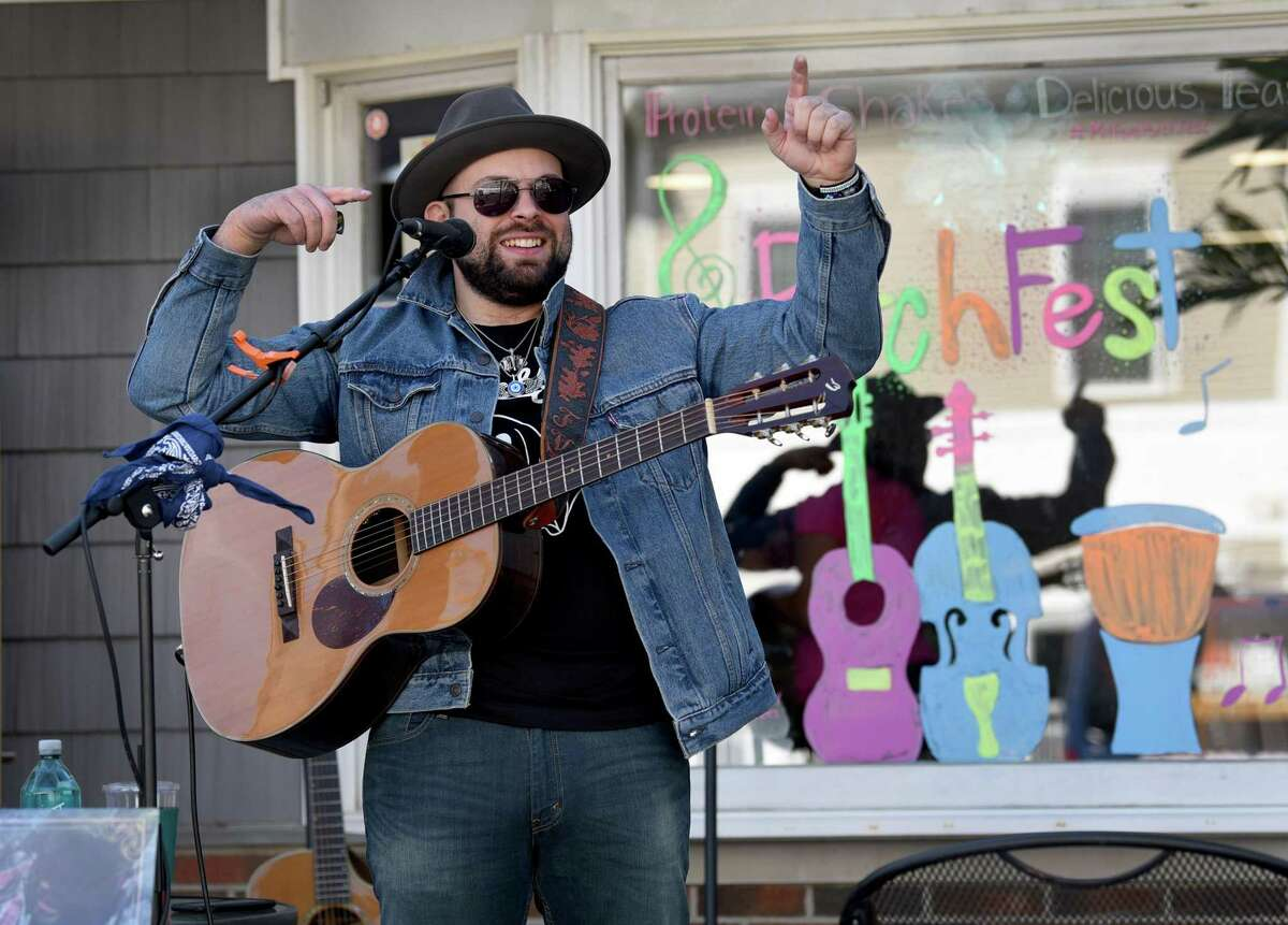 Musician Frank Viele performs in front of Seaside Nutrition on Naugatuck Avenue in Milford on Saturday.