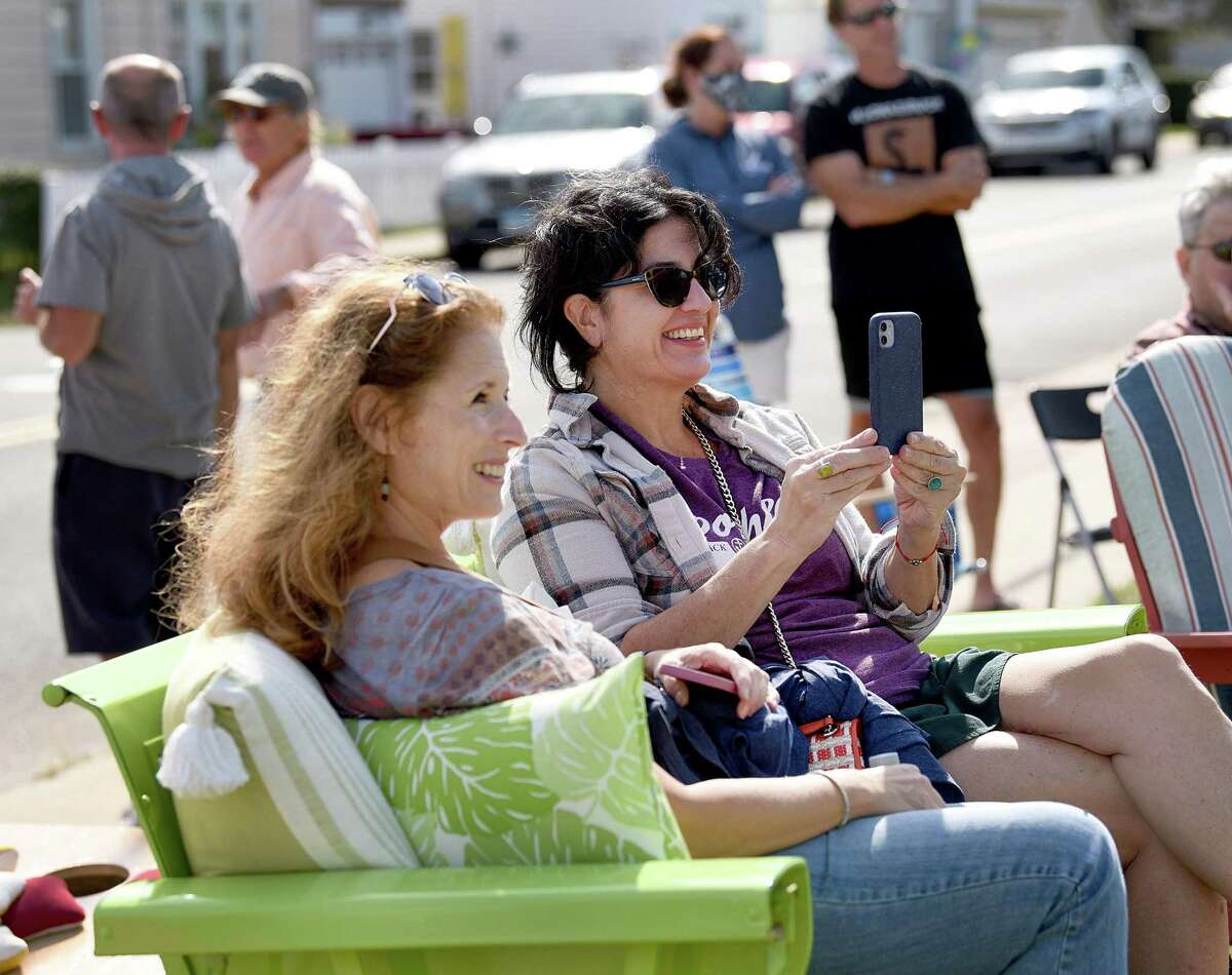 """Regina Rizzo, left, of Milford and Ann Arendt of Bridgeport listen to the sounds of the """"Sweet Louise Band"""" during Milford Porch Fest in Milford on Saturday."""
