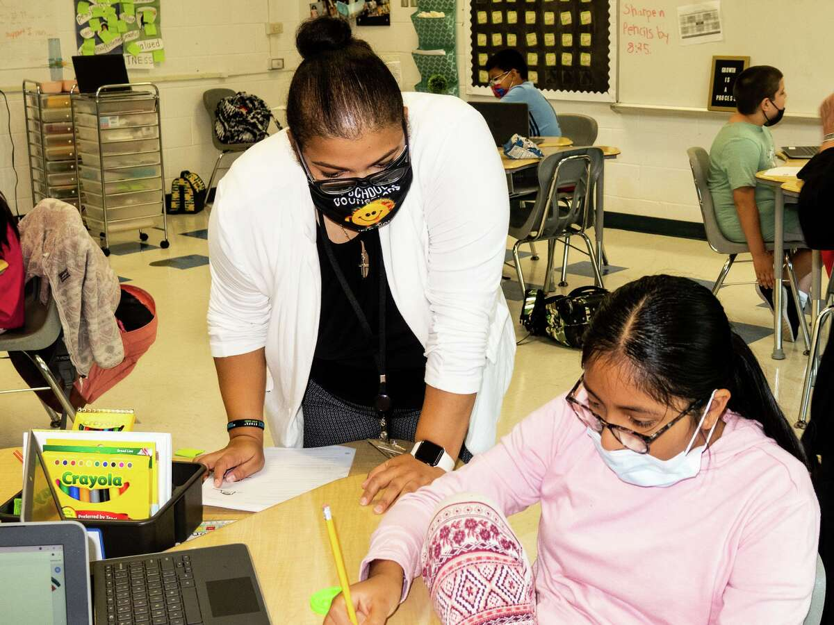 Guidance Counselor Fabiola Estevez works with Grace Moreno during the SEL lesson at Kendall School in Norwalk.