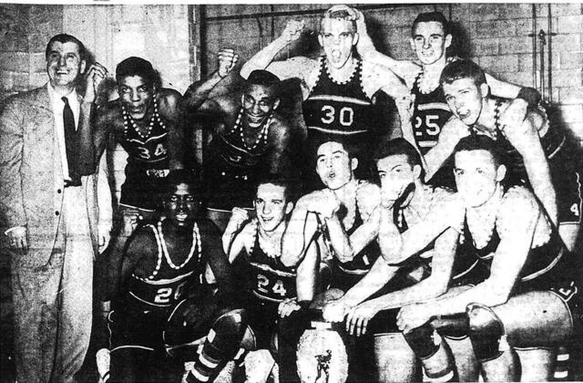 The Edwardsville basketball team poses for a photo after beating Effingham St. Anthony in the super-sectional to reach the state tournament. Front row, left to right, Bob White, Gordon Mallory, Lee May, Bryan Madison and Rich Pulliam. Back row, from left, coach Joe Lucco, Govoner Vaughn, Mannie Jackson, Buzz Shaw, Jim Chandler and Harold Patton.