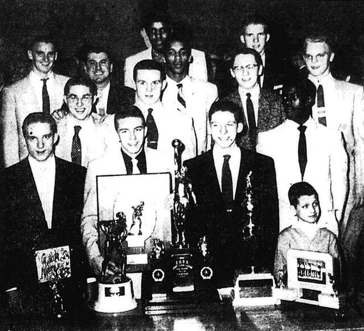 The Edwardsville basketball team, which capped the 1955-56 season with a second-place finish in the state tournament, poses for a photo. Front row, from left to right, Gordon Mallory, Bryan Madison, team manager Wade Buckles and Billy Lucco, the coach's son. Second row, from left, Lee May, Richard Pulliam and Bobby White. Third row, from left, Jimmy Chandler, coach Joe Lucco, Mannie Jackson, team manager Royce Dettmer and Buzz Shaw. Govoner Vaughn, left, and Harold Patton are in the top row.