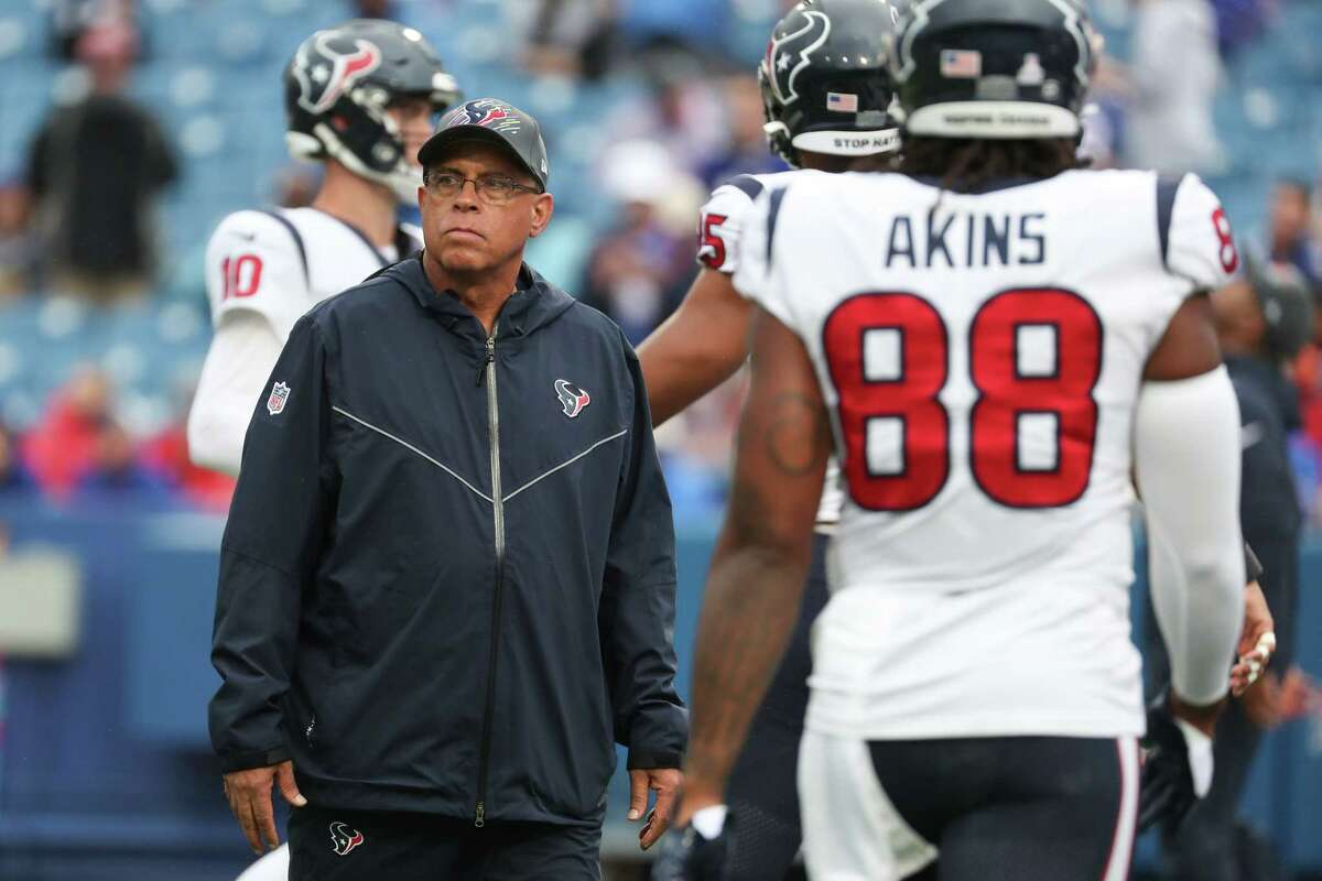 Houston Texans head coach David Culley watches his players warm up before an NFL football game against the Buffalo Bills Sunday, Oct. 3, 2021, in Orchard Park, N.Y..