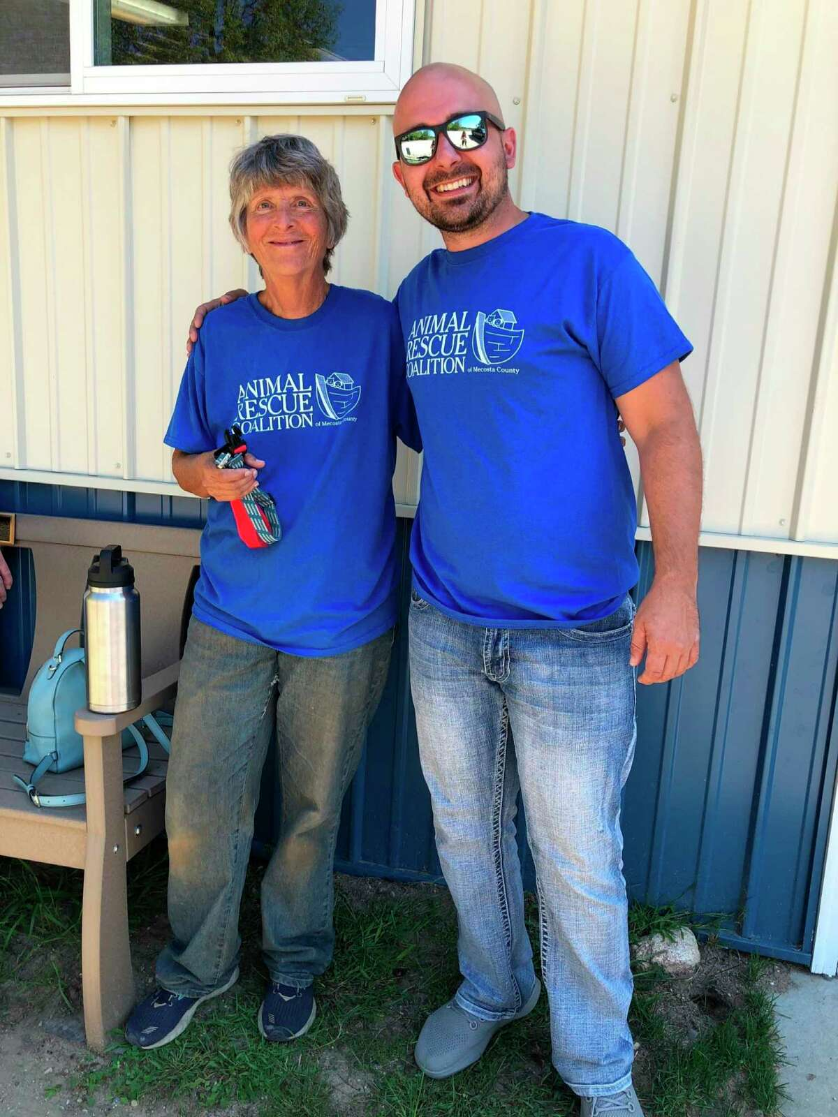 The Animal Rescue Coalition of Mecosta County is celebrating its ninth anniversary and director Cate Arroe (pictured left) has had thousands of successful adoptions including a recentadoption made by Steve Bokor (pictured right). (Courtesy/Cate Arroe)