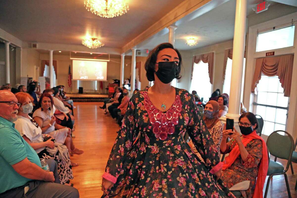 A model showcases an outfit created by an Afghan seamstresses during a fashion show organized by Catholic Charities. The event at the Woman's Club of San Antonio featured work produced by 14 seamstresses who have immigrated to the U.S. from Afghanistan.