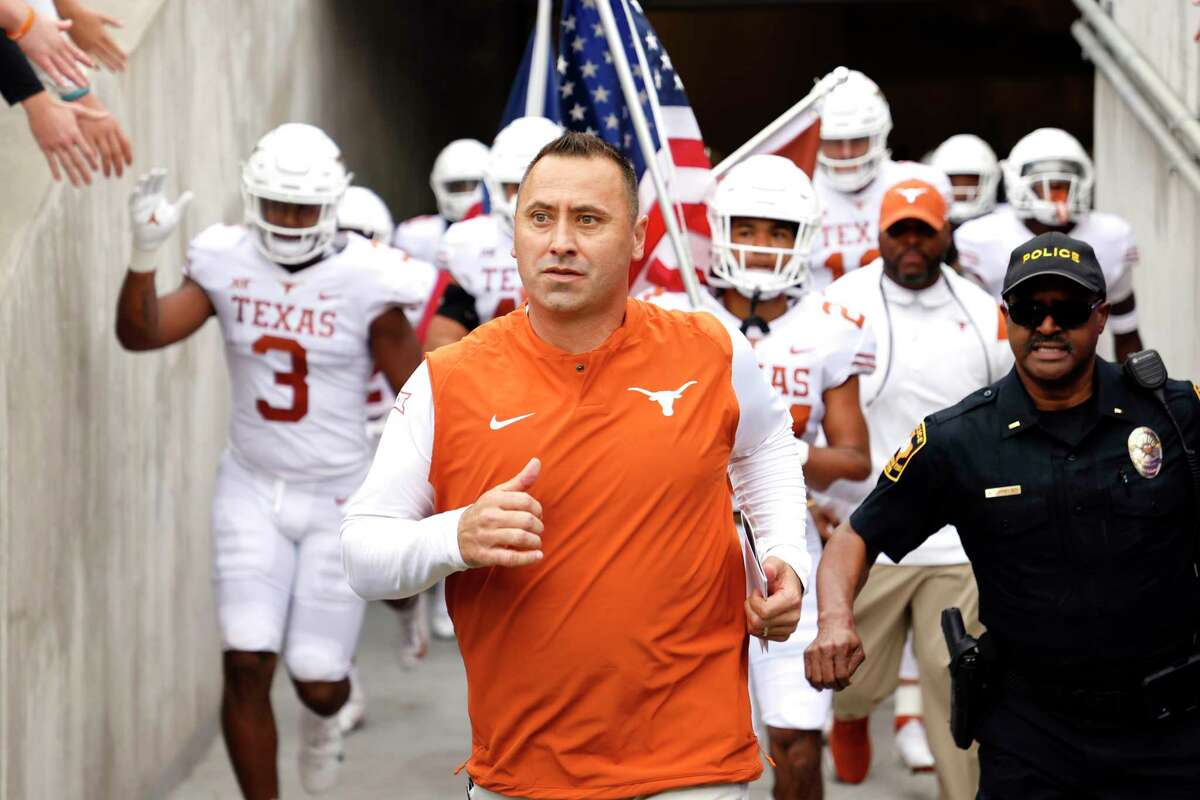 Texas head coach Steve Sarkisian leads his team to the field before playing TCU in an NCAA college football game Saturday, Oct. 2, 2021, in Fort Worth, Texas. (AP Photo/Ron Jenkins)
