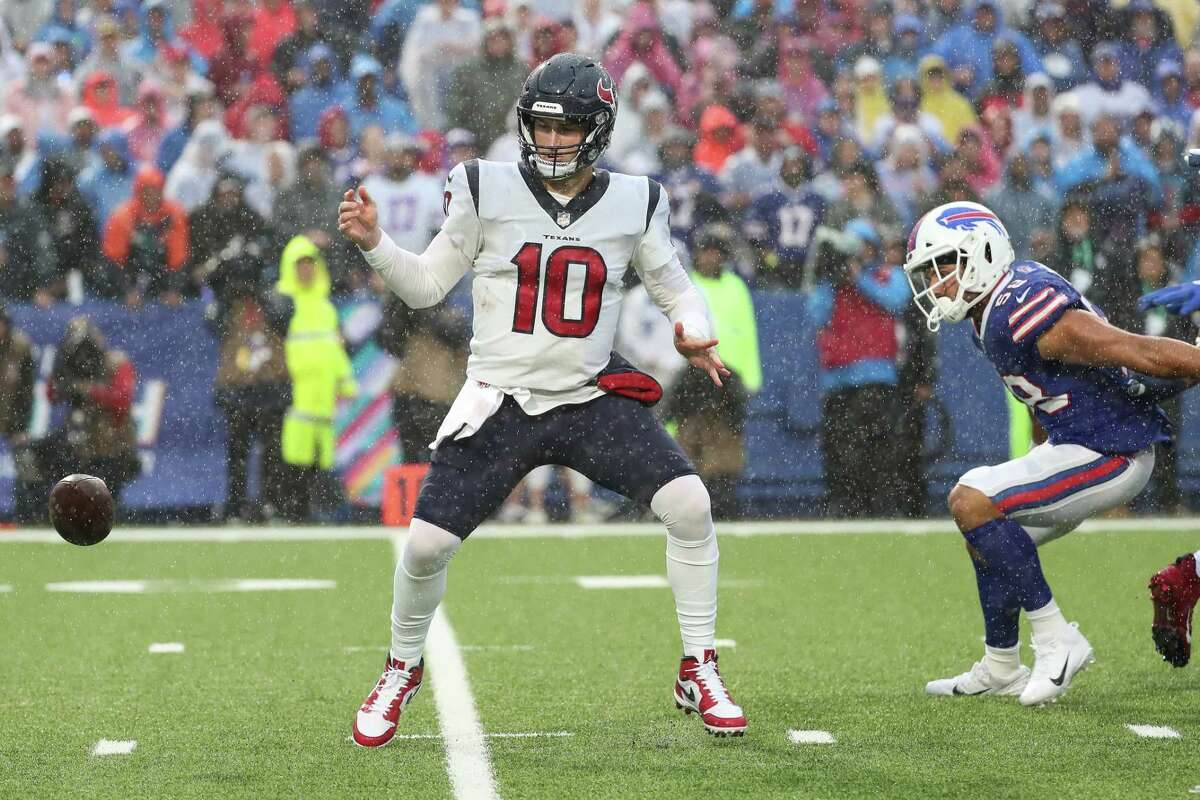 Houston Texans quarterback Davis Mills (10) loses the handle on the ball as he drops back to pass as Buffalo Bills linebacker Matt Milano (58) comes in to defend during the first half of an NFL football game Sunday, Oct. 3, 2021, in Orchard Park, N.Y..