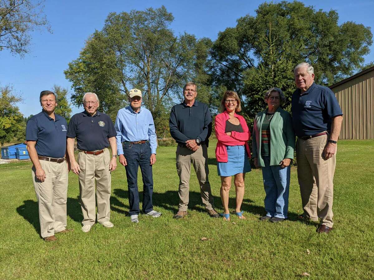 Attending the check presentation Friday for new picnic tables in Sanford's Village Park were, from left, Kiwassee Kiwanis Treasurer Alex Rapanos, secretary Gordon Rogers, vice president Duane Townley, Jerome Township Fire Chief Jerry Cole, Sanford Village President Dolores Porte, Martha Briggs, and Kiwassee Kiwanis President Bruce Rayce.(Tereasa Nims/for the Daily News)