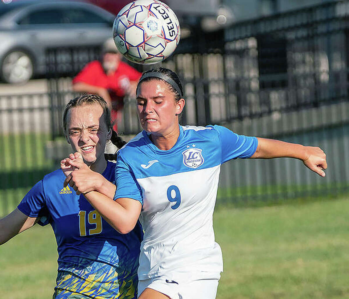 Lewis and Clark's Paige Bauer (9) and Illinois Central College's Kaylee Kleist battle during action Tuesday in Godfrey. Illinois Central beat LCCC 2-0 Saturday in East Peoria after Lewis and Clark won Tuesday's game 2-1.