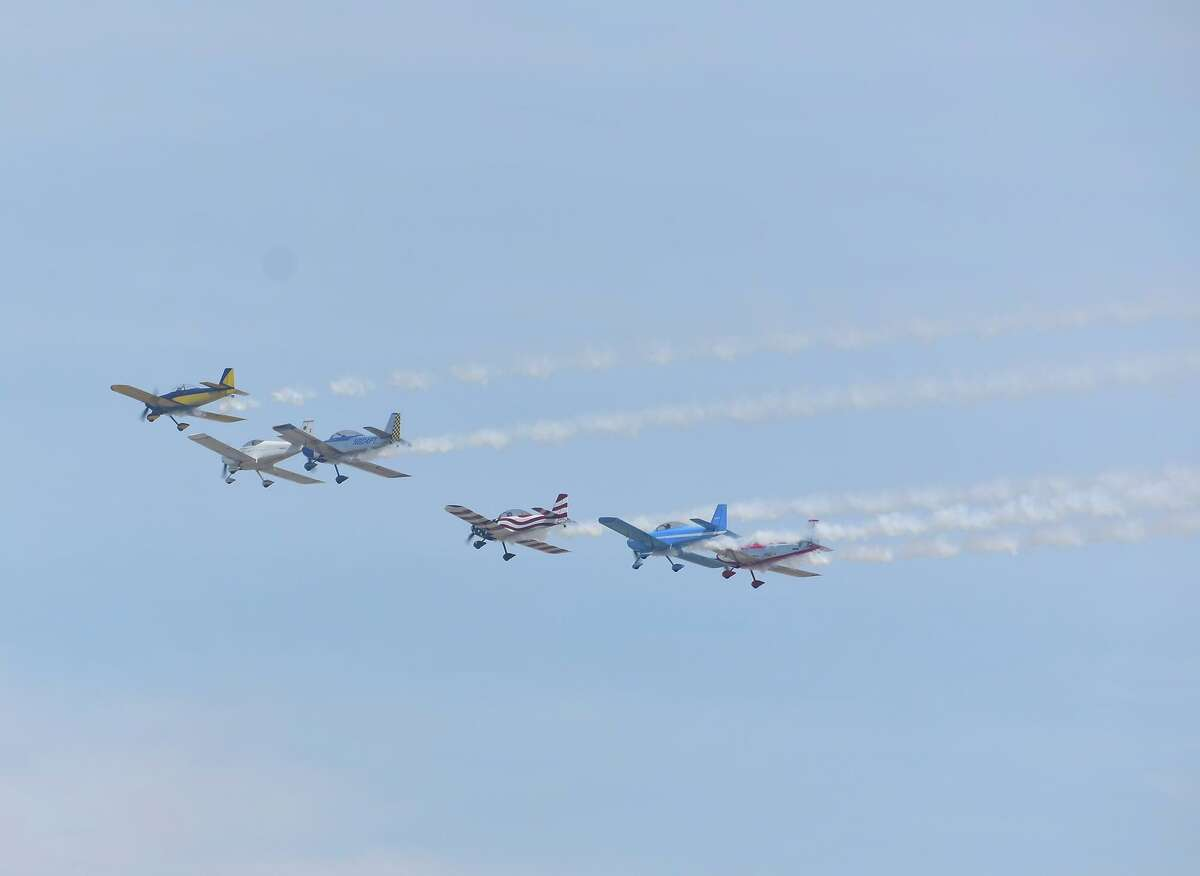 Planes fly in formation during the WBCA Stars and Stripes Air Show at Laredo International Airport on Sunday, Feb. 16, 2020.