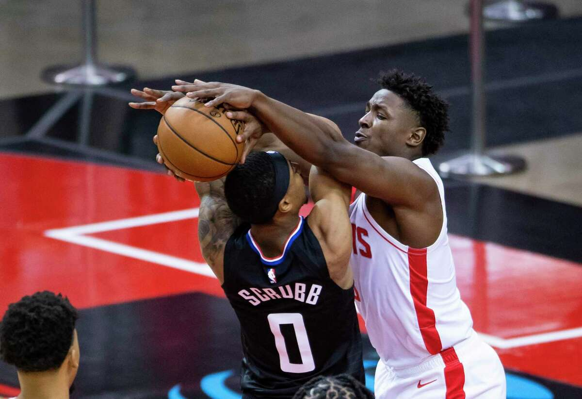 Jae'Sean Tate, defending against Jay Scrubb of the Clippers, was an old rookie last season and a young veteran this year.