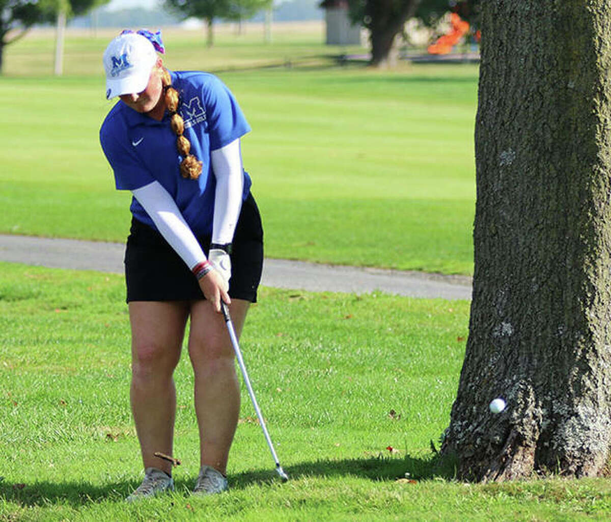 Marquette's Gracie Piar hits back on the fairway on the first hole Thursday in the regional at Belk Park in Wood River. Piar bogeyed the hole, but came back to shoot 7-under par 65 to win the tournament.