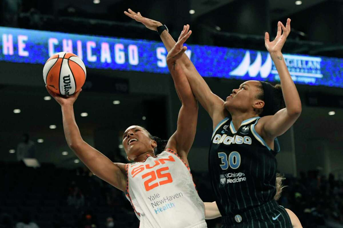 The Connecticut Sun's Alyssa Thomas (25) goes up to shoot against the Chicago Sky's Azurá Stevens in Game 3 of their semifinal series Sunday.