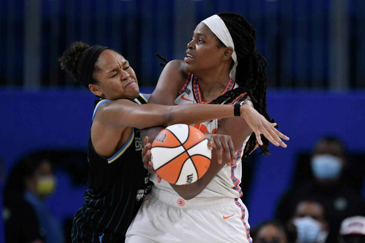 The Connecticut Sun's Jonquel Jones, right, looks to pass against the Chicago Sky's Azurá Stevens during Game 3 of their WNBA semifinal playoff series Sunday.